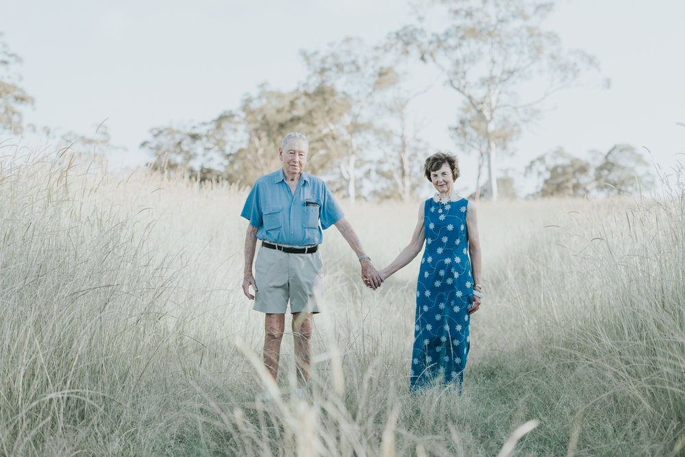 Elderly couple standing in long-grass | Sirromet Winery | Lightsmith Images