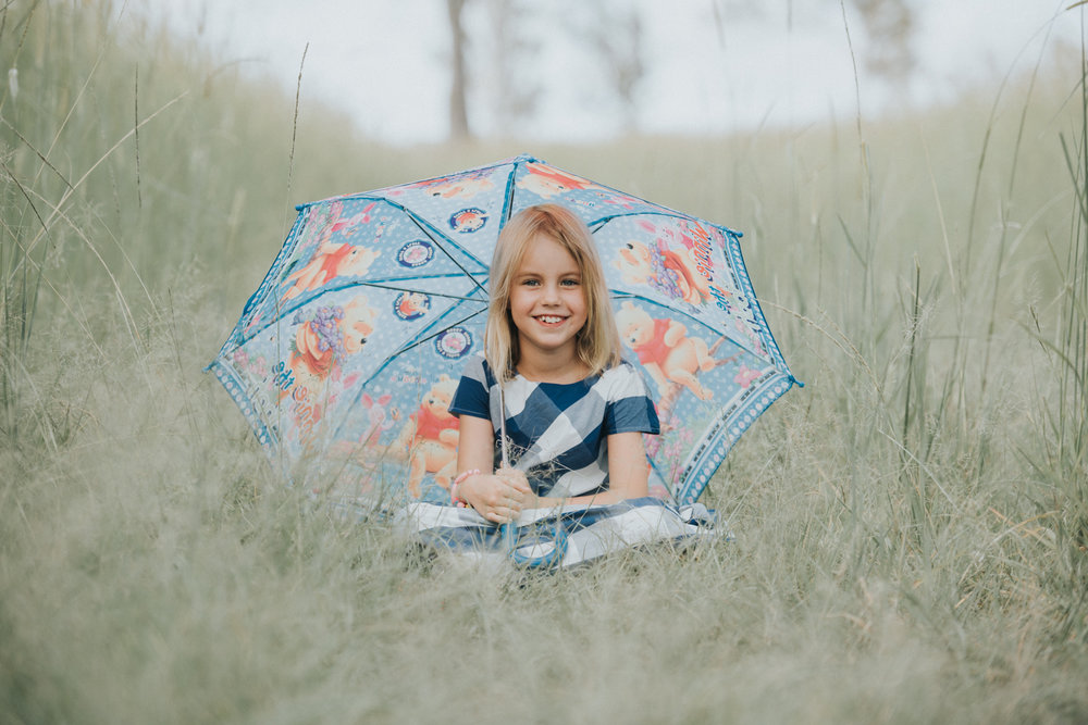 Pretty little girl under umbrella | Sirromet Winery | Lightsmith Images