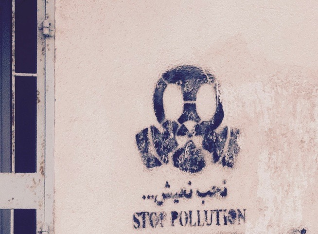 'Nheb Naish (We want to live): Stop Pollution' graffiti in the city of Gabes, where Tunisia's phosphate industry poison's people, animals, land, and sea.