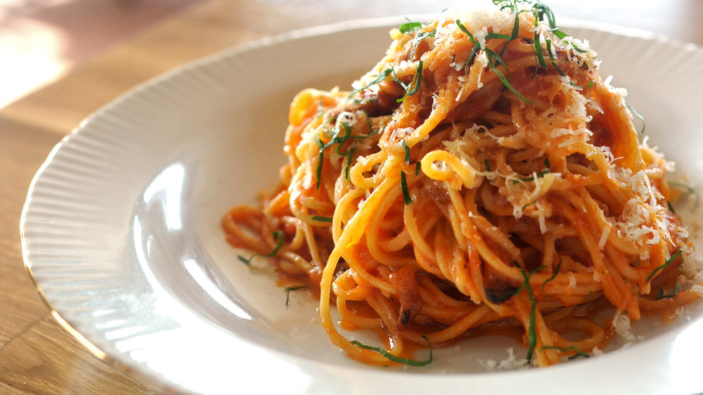 Pasta All'Amatriciana: bucatini or spaghetti, guanciale, tomatoes, pecorino, and dried hot chili pepper