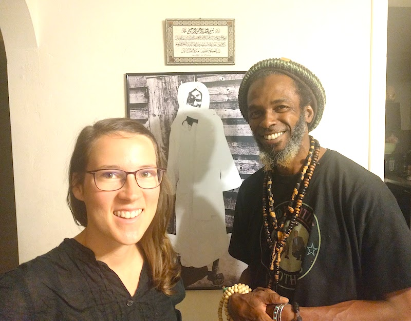 Khalifah and me in front of a photo of Cheikh Ahmadou Bamba, creator of the coffee blend.
