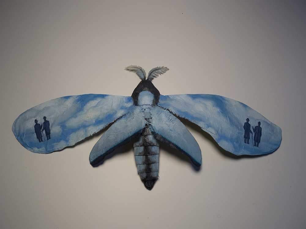 "Moth No. 4/Magritte.  11""x5"", oil on paper, glue, wire.   New work for the show at Bunnycutlet Gallery, which closes on the 24th."