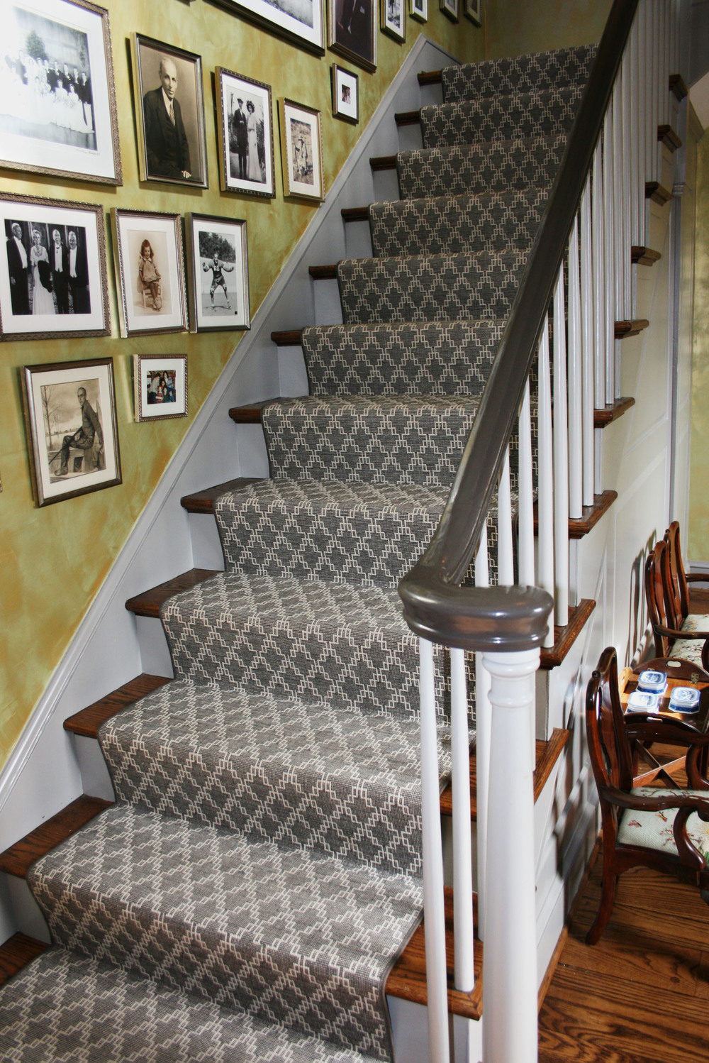 This image features a flat woven stair runner that was custom installed.