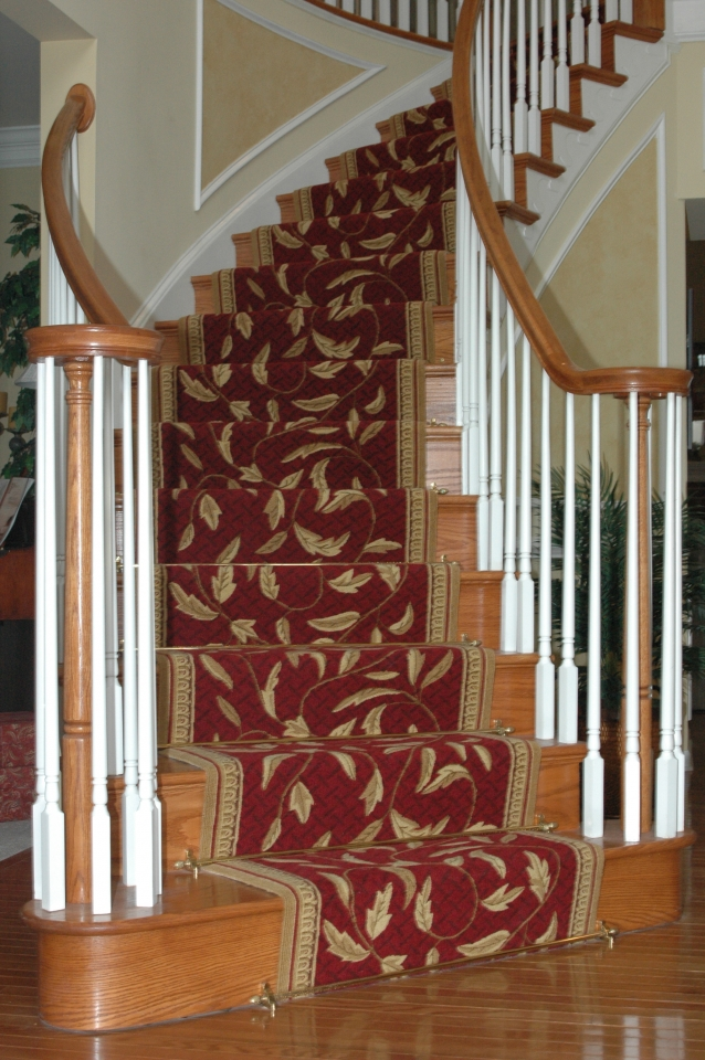 Traditional style custom designed and custom installed wool stair runner with decorative stair rods