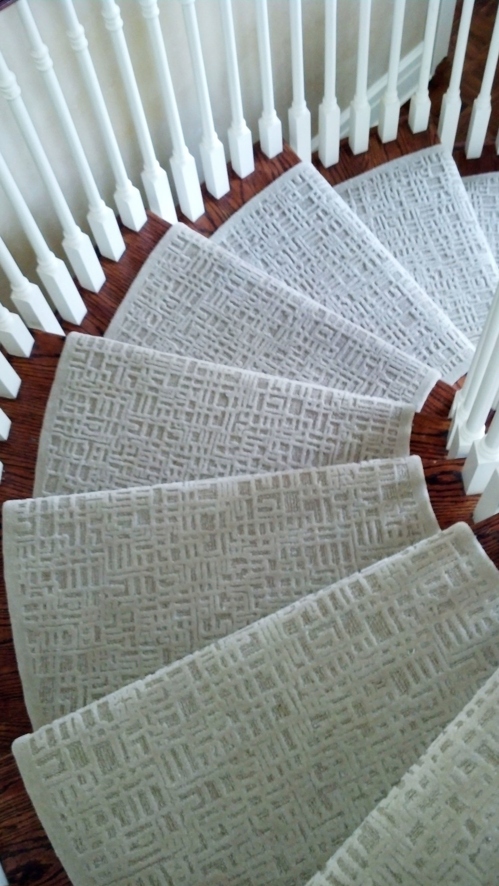 Custom design and custom installation tone-on-tone wool stair runner with a geometric random pattern