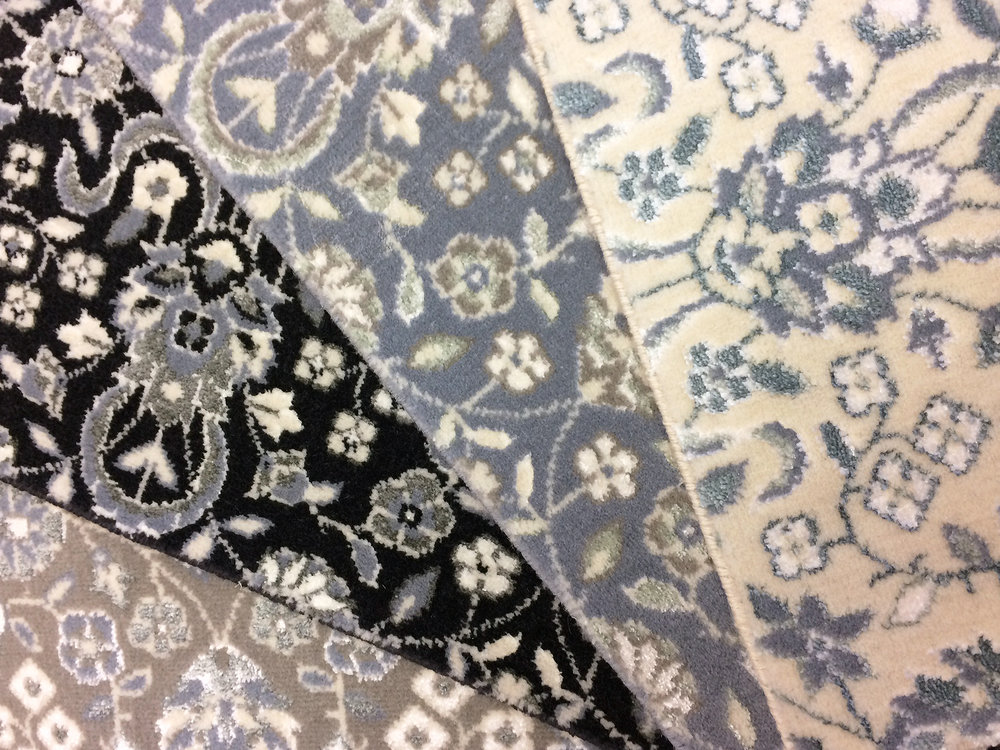 Oriental style carpet samples in grays