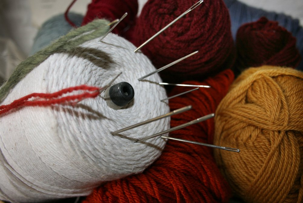 Some of our wool yarns, thread, and needles for repairing rugs