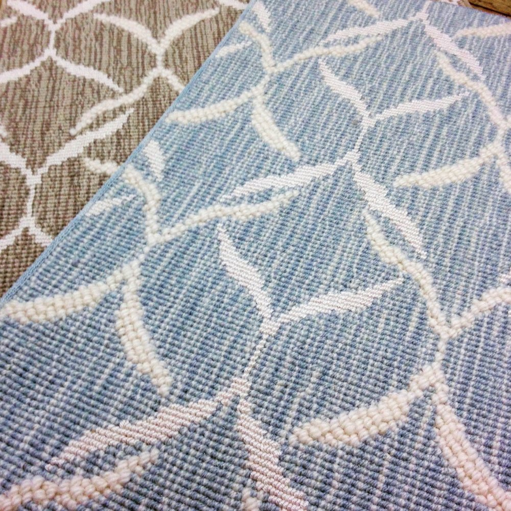 Blue and brown wool carpet samples with white geometric accents