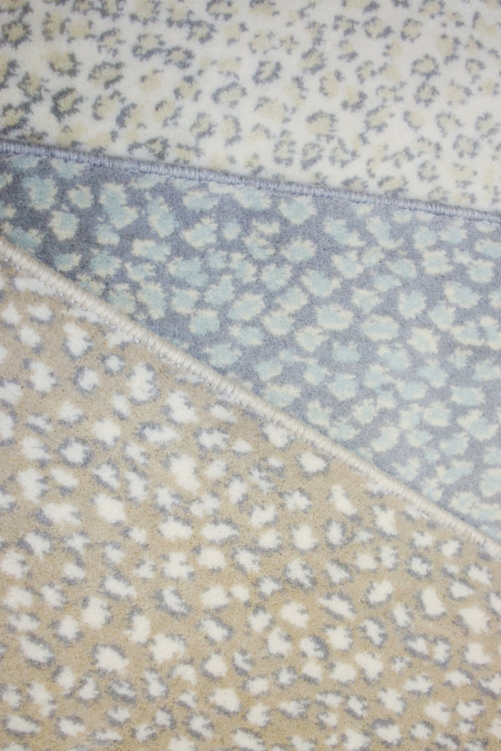 Subtle animal print carpet in pale blues