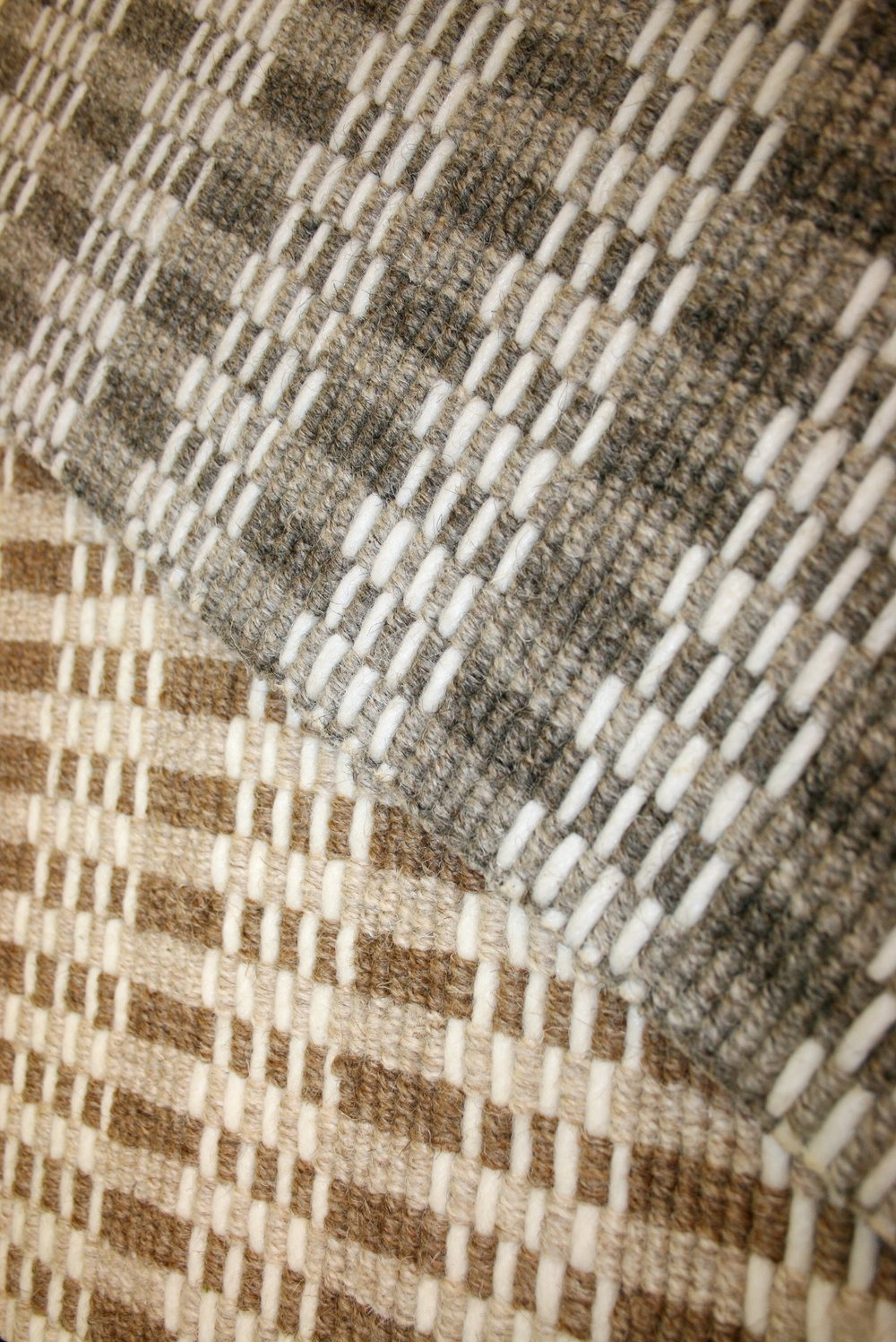Plaid wool carpet in neutral and gray