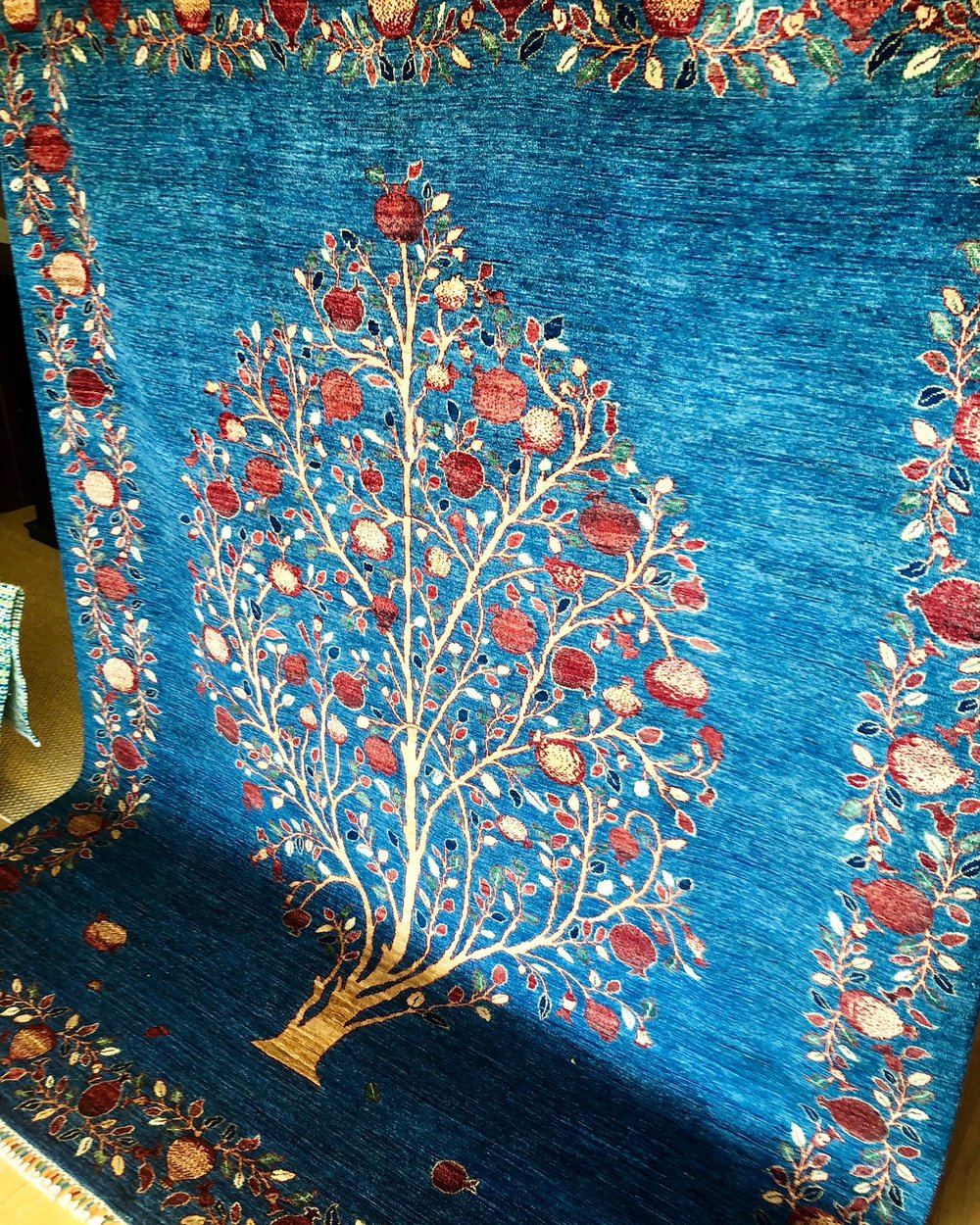 Pomegranate tree rug, symbolizing fertility, abundance, and good health.