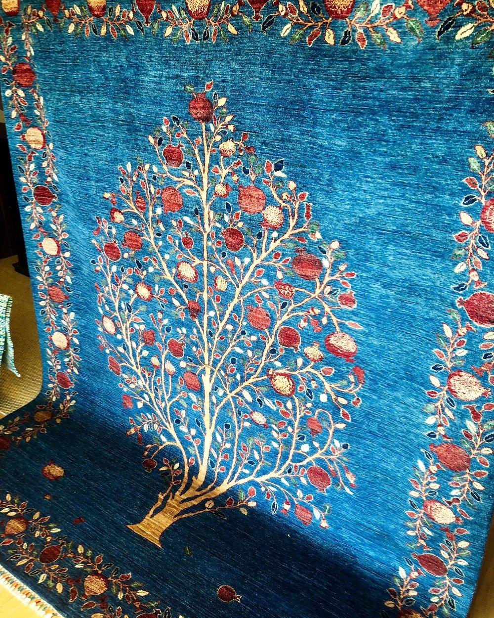 Pomegranate tree rug, symbolizing fertility, abundance, and good health.