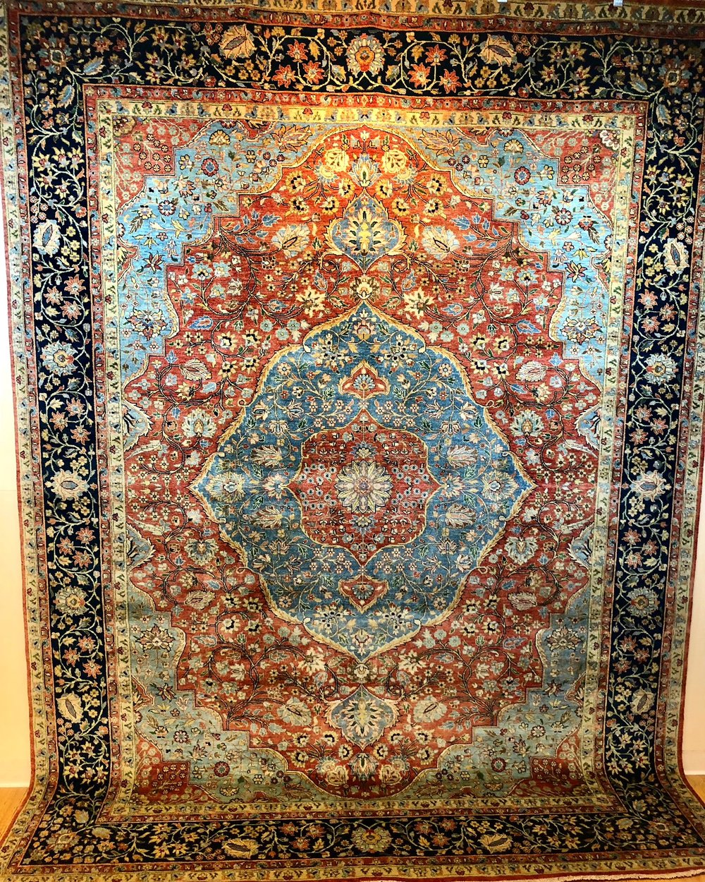 Rust and light teal center medallion rug.