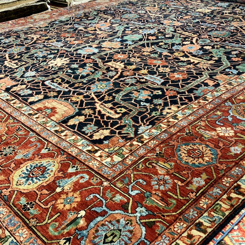 Rust, green, and light blue hand-made rug