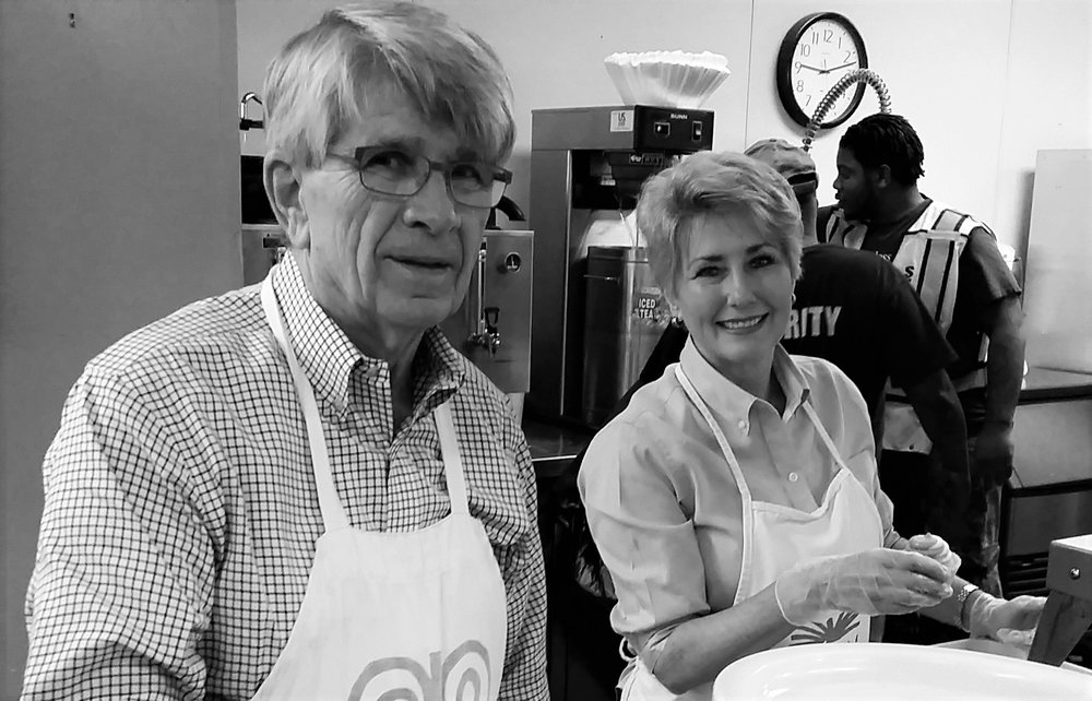 Dr. Pete and Karen Dosser serving in the soup kitchen on the day they sponsored.