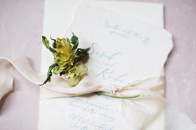 Life has deckled edges, appreciate that | So in love with silk ribbon embellishments and marine blue script on off white handmade paper.  This week has been full of unfolding, revealing, growing out, finding solutions. Life is never a straight line. Its deckled edges makes us stronger and more beautiful human beings. VENDOR CREDITS: Design & Planning: @haloeventdesign Photography: @ericamelissa_ --- Model: @lukewarmeric85 Model:  @bodybululu --- Bridal Dress: @aandbe_bridalshop @madewithlovebridal Cake/Sweets: @sweetguiltbyangelica  Catering: @yummychori  Cinematographer: @bricksgroup  Calligraphy | Invitation Suite: @inkpushco  Floral Design: @simpleflorals Grooms Attire: @mygroomsroom @thelapelproject H&MUA: @giadespo  Jewelry: @liaterni  Lighting: @eventfactor Furniture Rentals: @elementsandaccents  Shoes: @bellabelleshoes  Tableware: @themixdish  Table Arbor Rental: @smartbitestogo  Venue: @spanishmonastery . . . . #moderncalligraphy #fineartcalligraphy #botanicalillustrator #romanticwedding #look4lykke #thatsdarling #liveauthentic #pursuepretty #theartofslowliving #postitfortheaesthetic #refinedcalligraphy #washingtondccalligrapher  #inkpushco #destinationwedding #charlestoncalligrapher #savannahcalligrapher #newyorkcalligrapher #nyccalligrapher  #weddinginvitations #stationers #makersmovement #silkribbons #waxseals #artofscript #prettyletterseverywhere #handmadepaper #dailydoseofpaper #decklededges #paperlove #brooklyncalligrapher