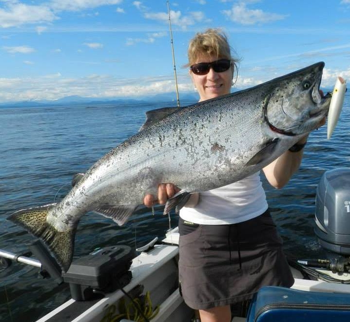 Brenda on the boat with a Spring salmon