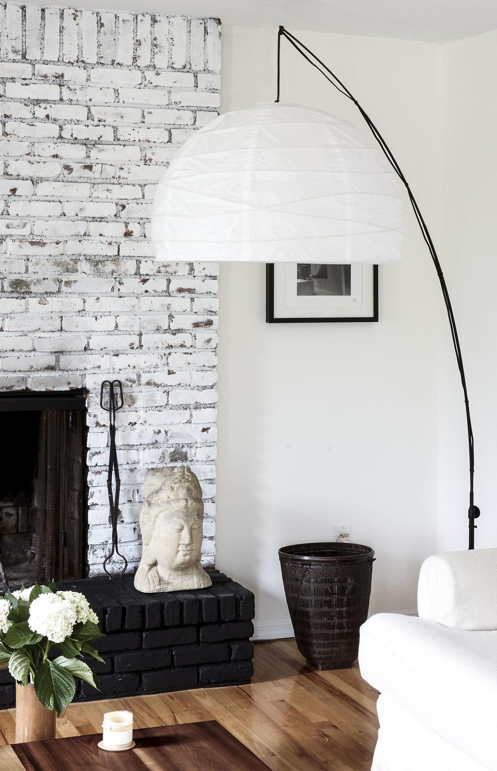 Amagansett Beach House home interior family room fireplace white exposed brick