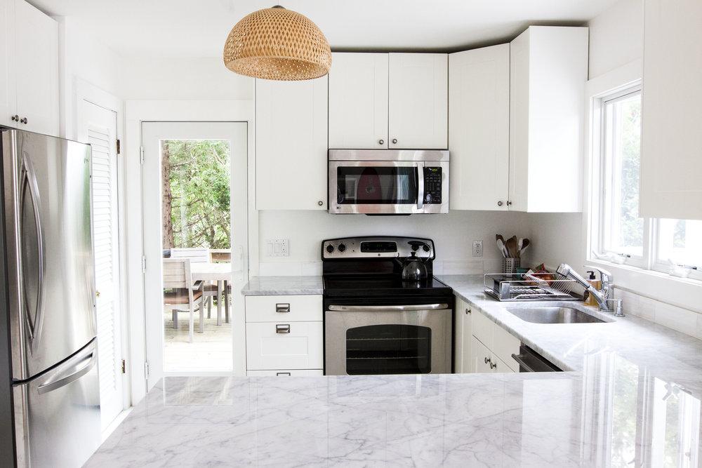 Amagansett beach house interior kitchen white modern minimal