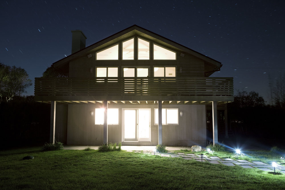 Montauk Beach Home upside house exterior nighttime with balcony