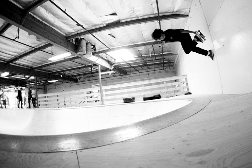 California indoor skate park boy skating black and white