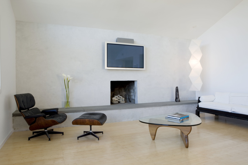 Montauk Beach Home upside house interior fireplace living room eames