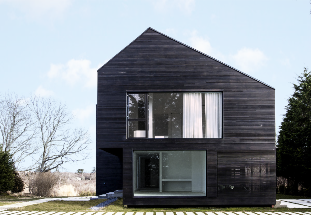 Black Modern barn house with Shou Sugi Ban cedar siding and windows