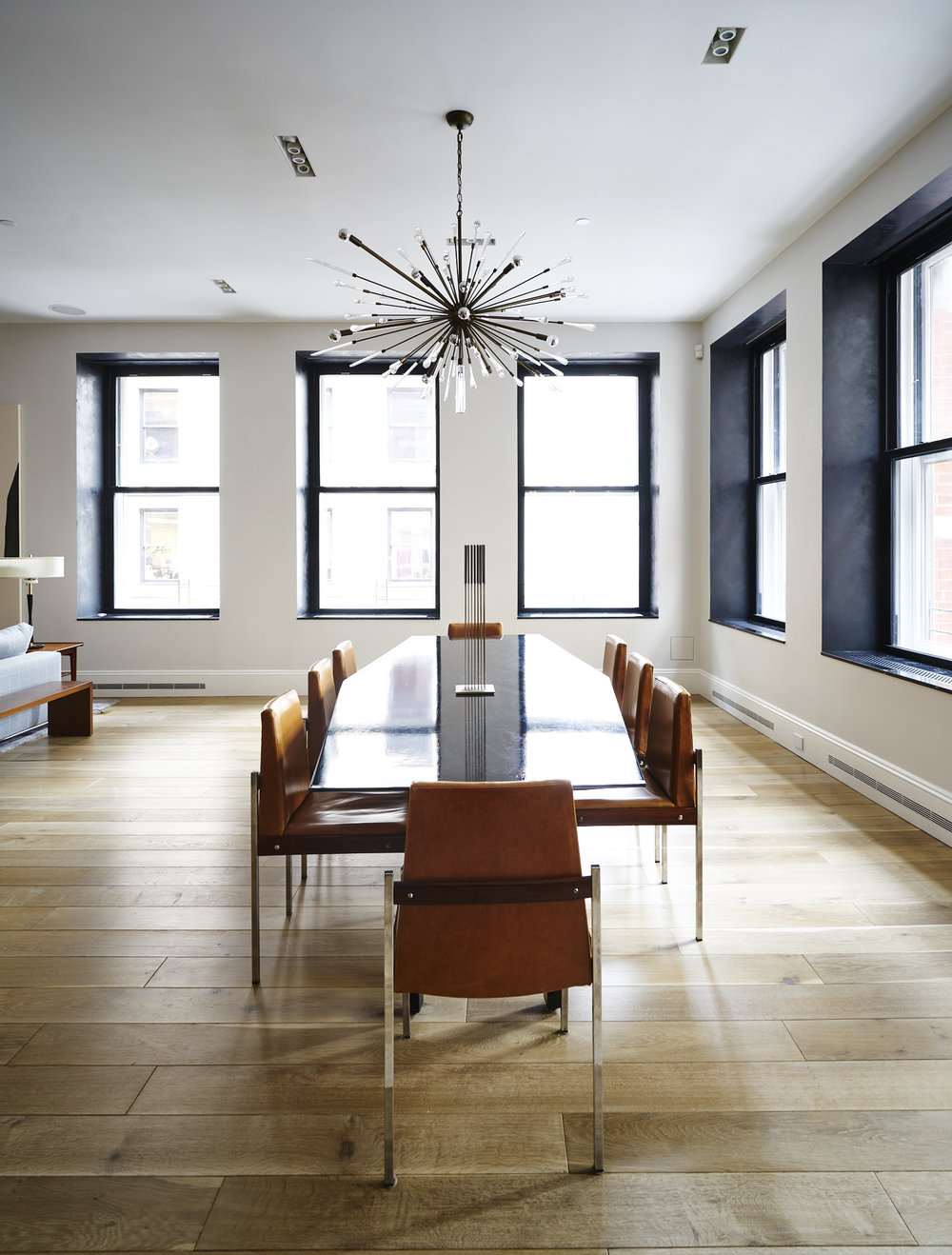 Modern Soho loft dining room interior with chandelier