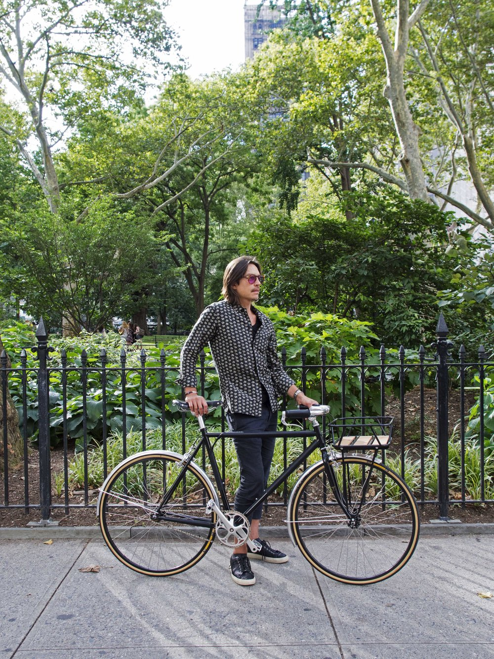 Men's black bike Madison Square Park spring New York city