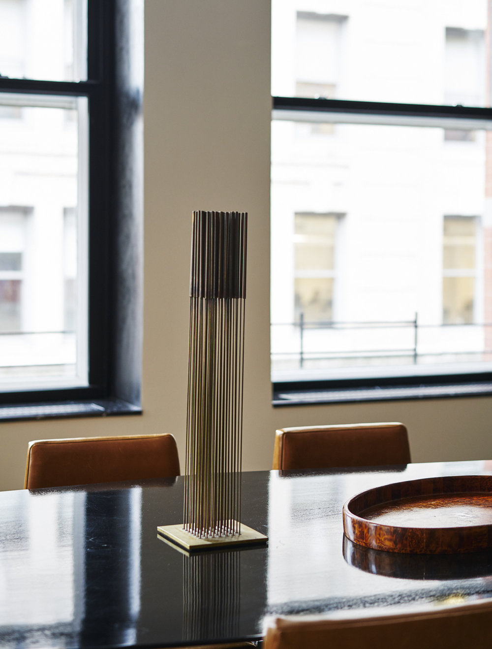 Modern Soho loft renovation dining room table and Bertoia sculpture