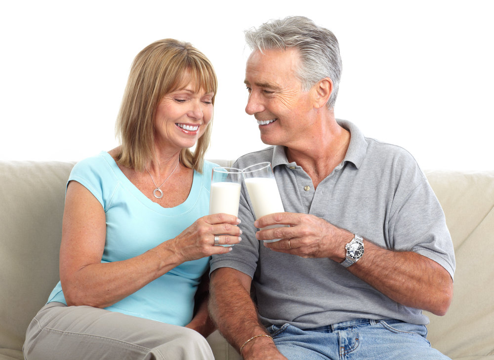 Older woman and man drinking fortified milk powder