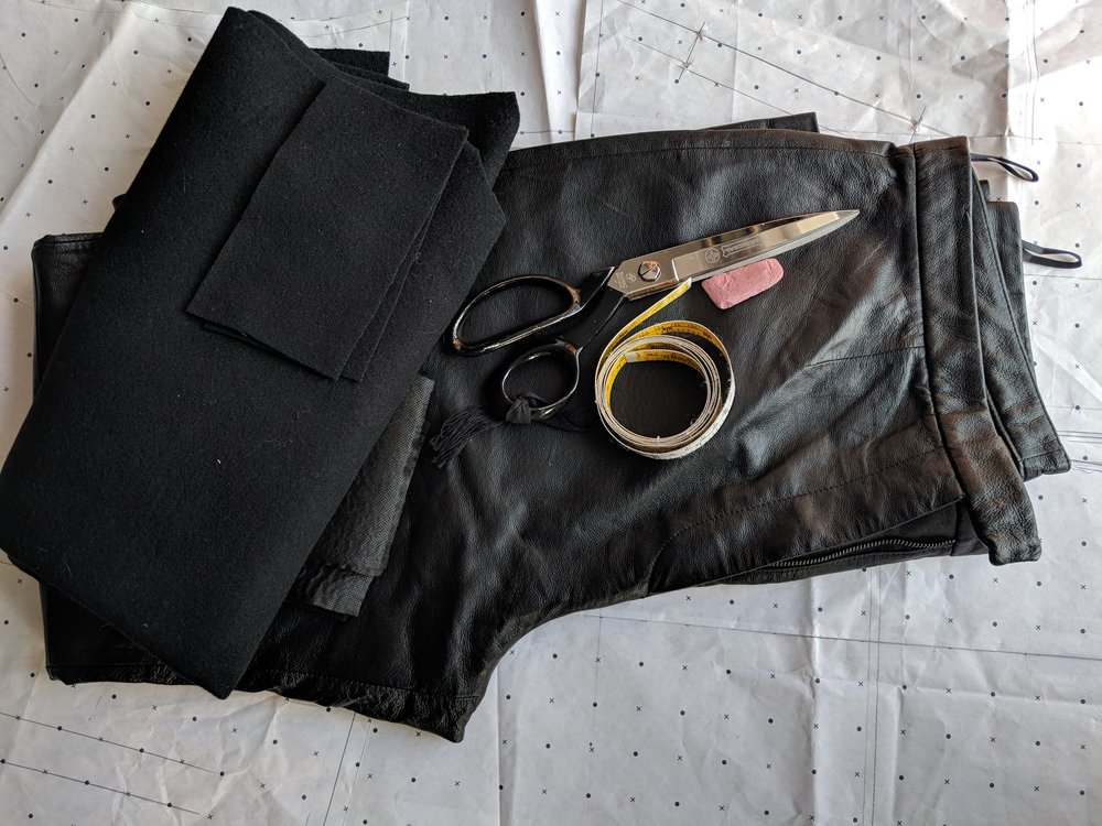 Leather trousers for the sleeves and Coat factory scraps for the body.
