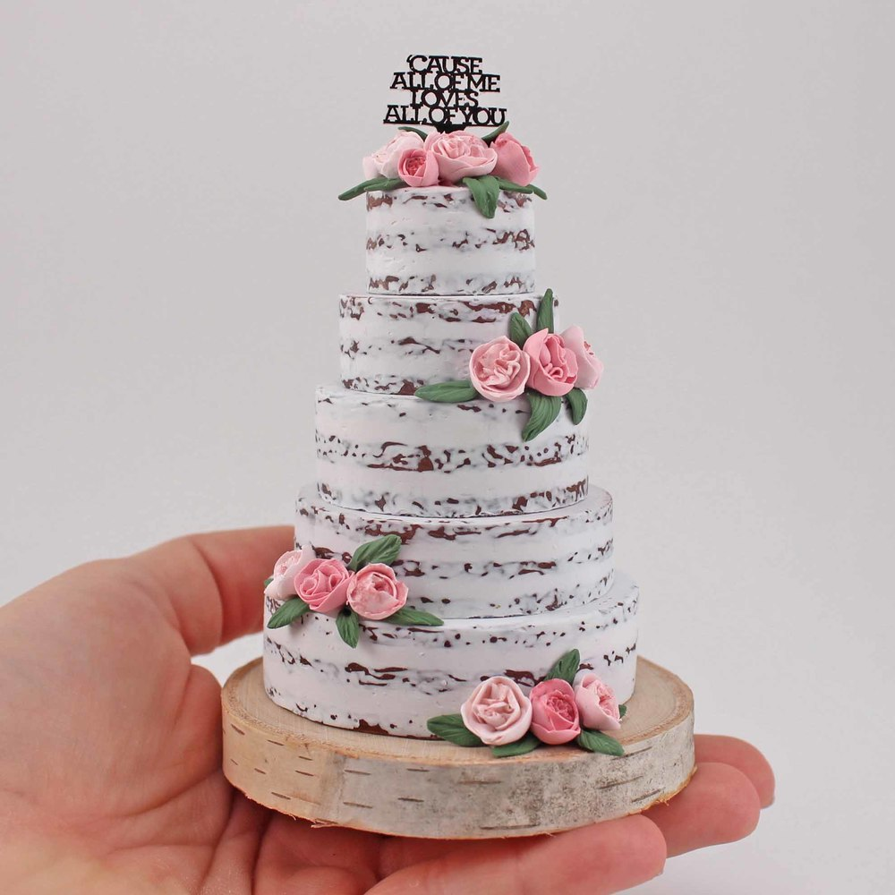 minature replica of a semi naked cake.jpg