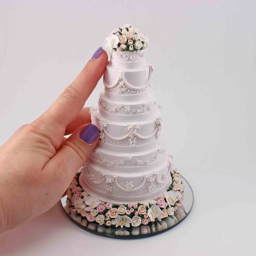 Six tier butter cream cake with natural flowers mini replica.jpg