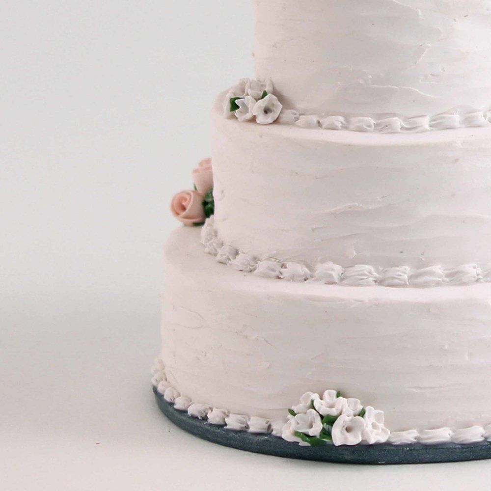 minature of a white buttercream textured wedding cake detail.jpg