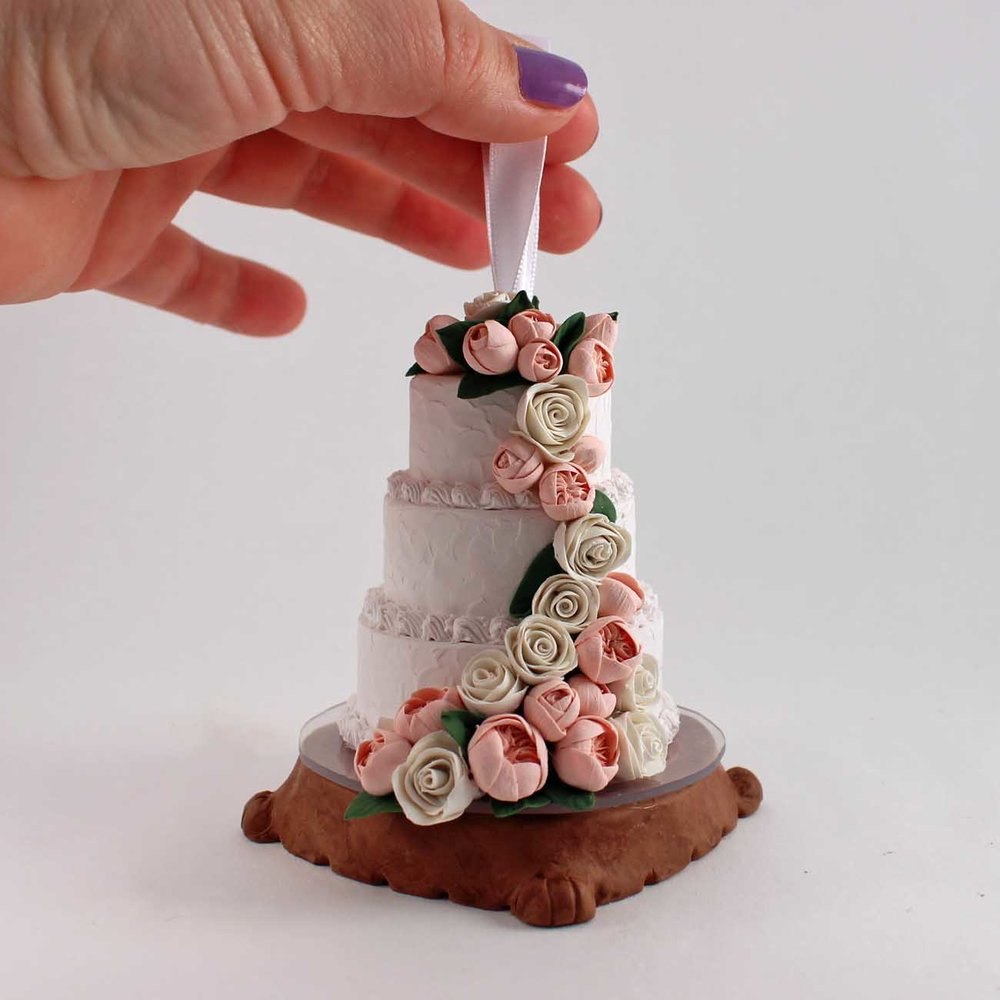 mini wedding cake replica of cake on wood base.jpg