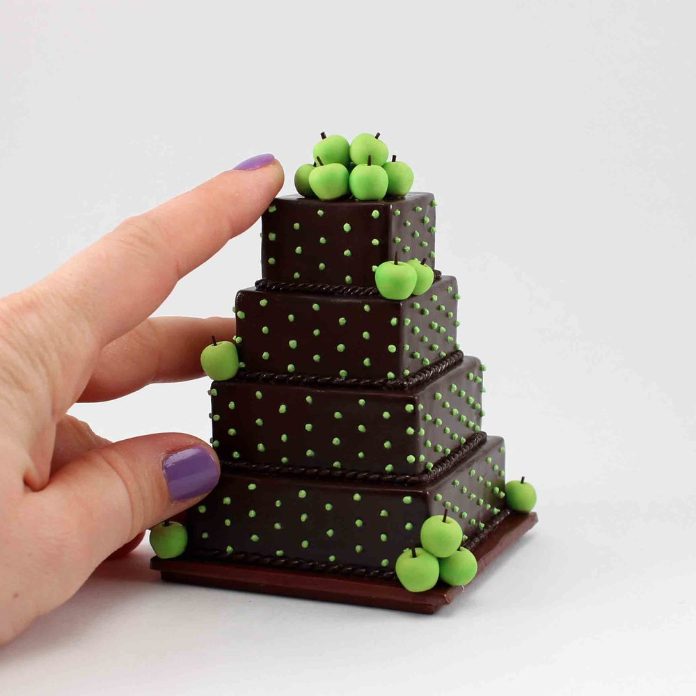 mini wedding cake replica of chocolate cake with green apples.jpg