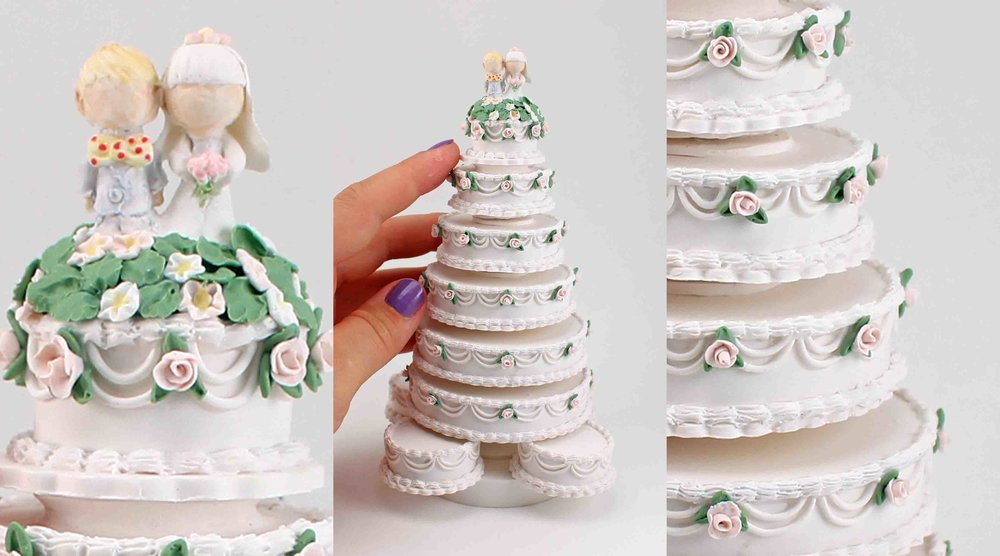 Minature replica of a seven tier white wedding cake.jpg