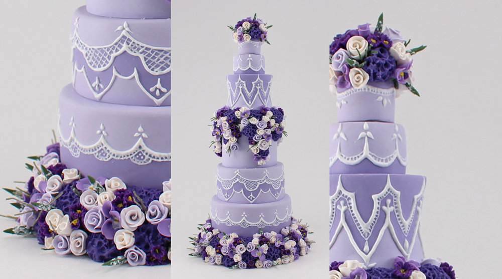 minature purple wedding cake with hand made flowers.jpg