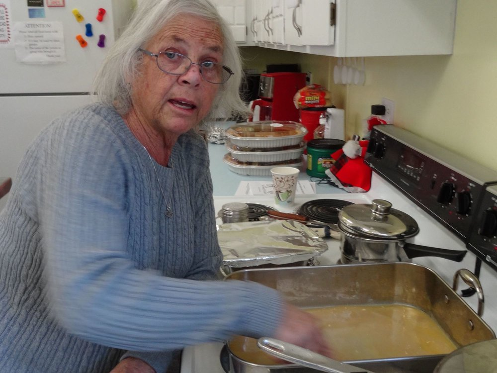 Carol Johnson stirs gravy.jpg