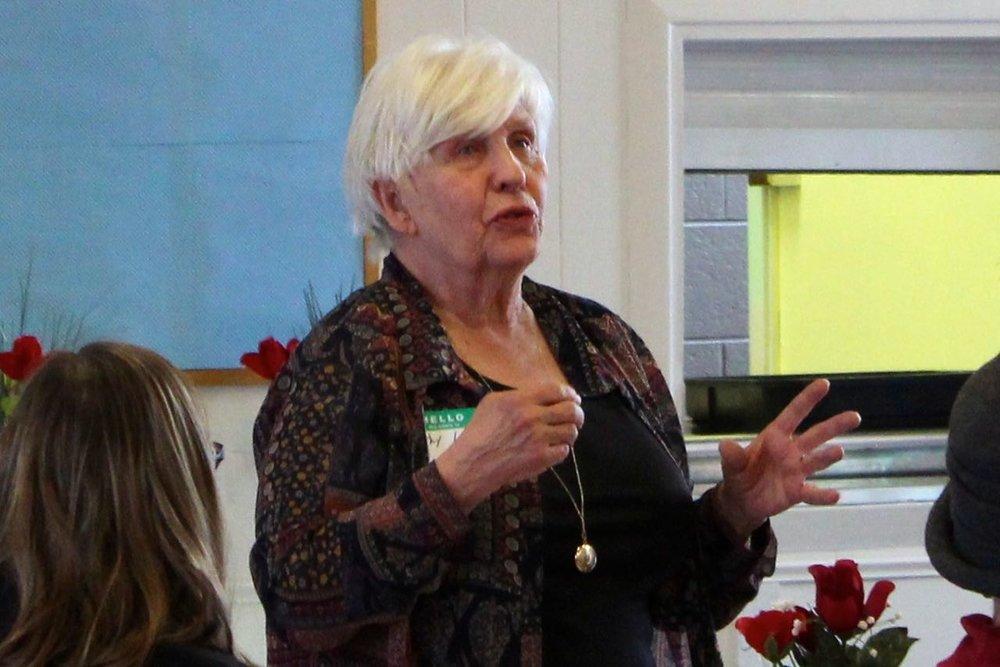 Cathy Loomis delivers Heritage Room report.jpg