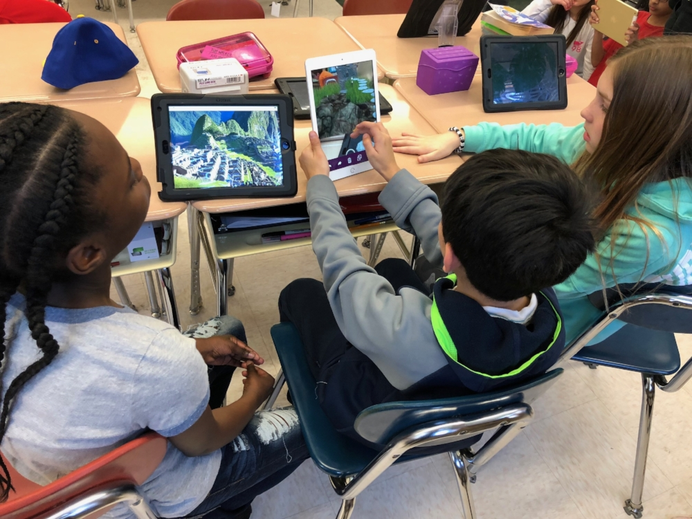 A classroom in the U.S. where the students are using 3DBear AR to restore a virtual Machu Picchu.