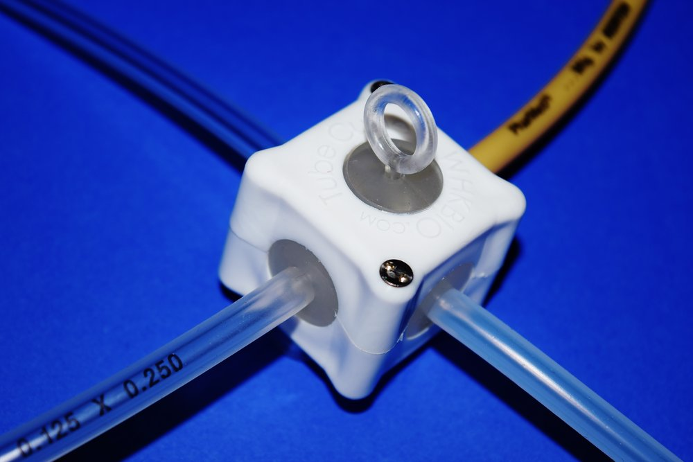 TubeCube™ Tubing Connector System - WHK's TubeCube™ Tubing Connector System is a revolutionary way to join C-Flex®, PharMed®, silicone and TPE tubing.* No need for step-down connections. Fewer connections mean lower priced assemblies, less chance for leaks or contamination, and faster turn-around. Get the strength of overmolding without the overmolded price!  Click Here to Learn More!