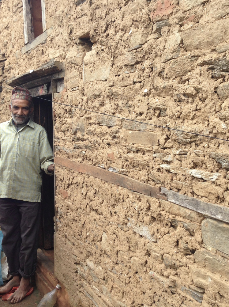 Nodanath Mishra, one of the kindest men I know, stands next to his newly built home. Similar to those built before the earthquake, this home is made of stone and mud.