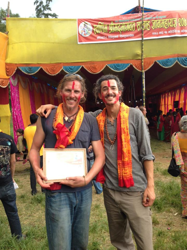 "Cofounders, Allen and Orion, standing proudly with their ""best dancing"" award they received from a community celebration."