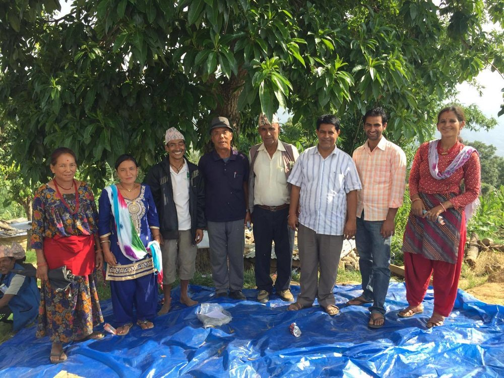 "Our ""Basic Organic Coffee Cooperative."" Elected chairman Narayan Bhattarai stands third from the left and the Sakute offical stands third from the right. The committee is 3 men and 4 women, and represents 4 different casts within the community."