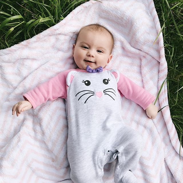 """These spring days are best spent laying in the grass..with my little L'Acadie.  Every gummy smile of hers is a reminder that the sleepless nights, the """"unproductive"""" days, all of it...is so so worth it."""
