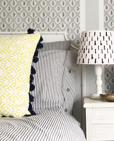 How to add pops of colour to a grey bedroom decor.