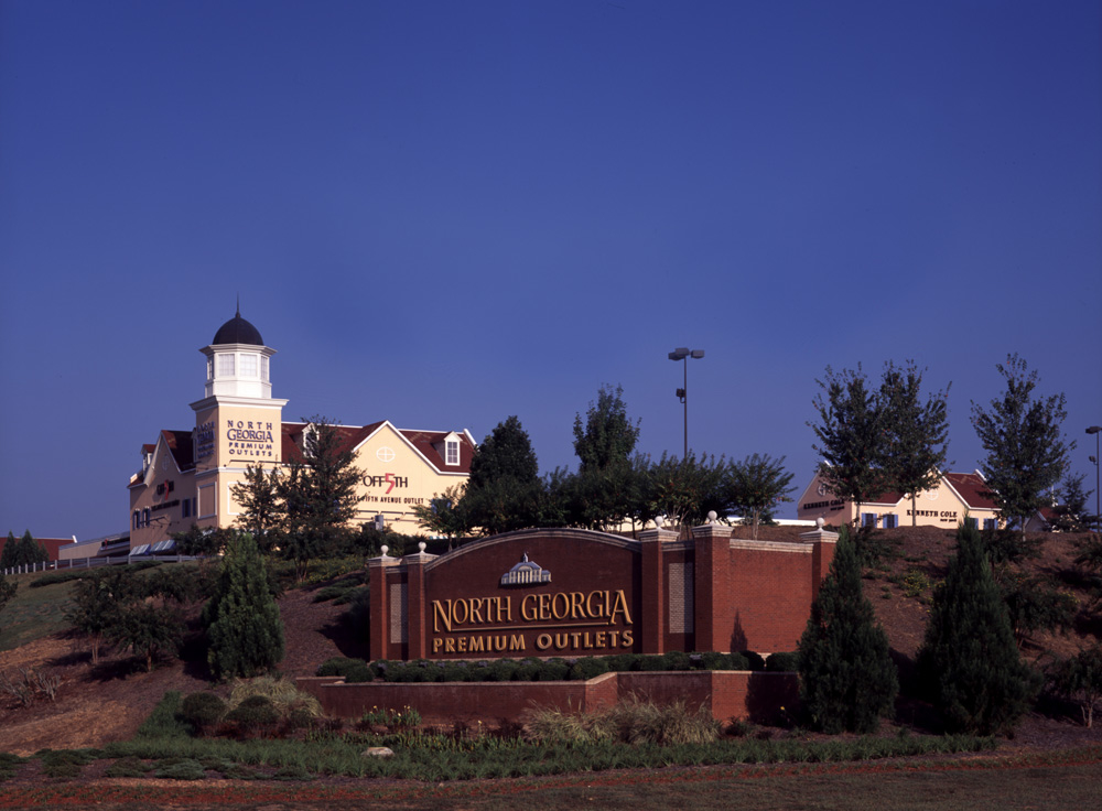 North Georgia Premium Outlets   North Georgia Premium Outlets is an outdoor Georgian-style village located 45 minutes north of Atlanta on Highway 400. Shop more than 140 outlet designer and name-brand outlet stores including Burberry, Coach, Gap Outlet, Nike, Pottery Barn Outlet, and Polo Ralph Lauren Factory Store. Enjoy exceptional brands at extraordinary savings of 25% - 65% everyday for shopping that's always worth the trip.
