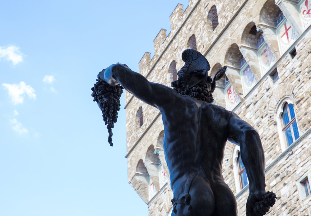 This photo was taken in August 2013 while away with the family in Florence, Italy.  Crowds and summer heat almost wore me out, but this radiant sculpture jolted me awake. The setting is the  Piazza della Signoria .